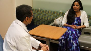 Dr. Naren Ramakrishna speaks with a patient, Rhea Birusingh, before she undergoes proton therapy to treat a tumor found behind her eye during her pregnancy. Rhea is the first patient to be treated at the new proton therapy center at UF Health Cancer Center - Orlando Health.